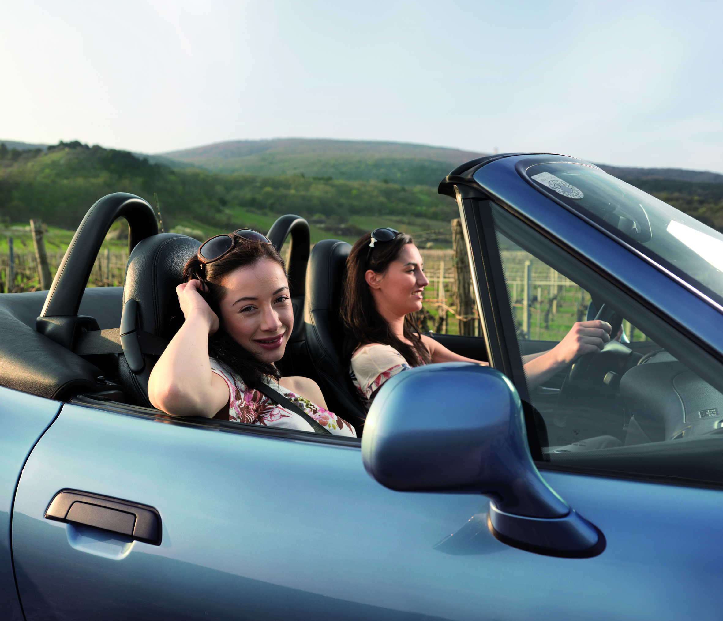 Two women in cabrio