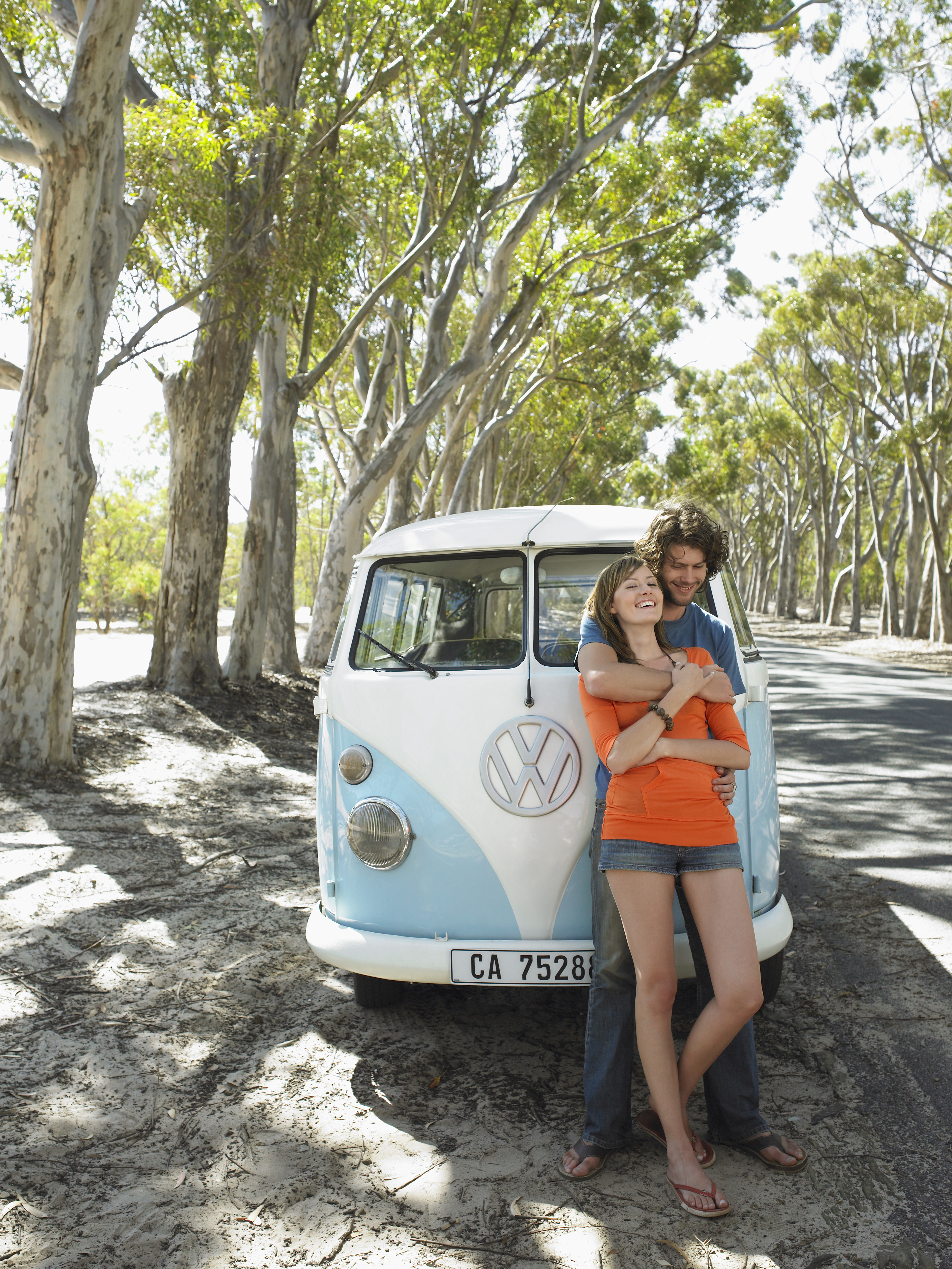 Couple in front of a VW bus