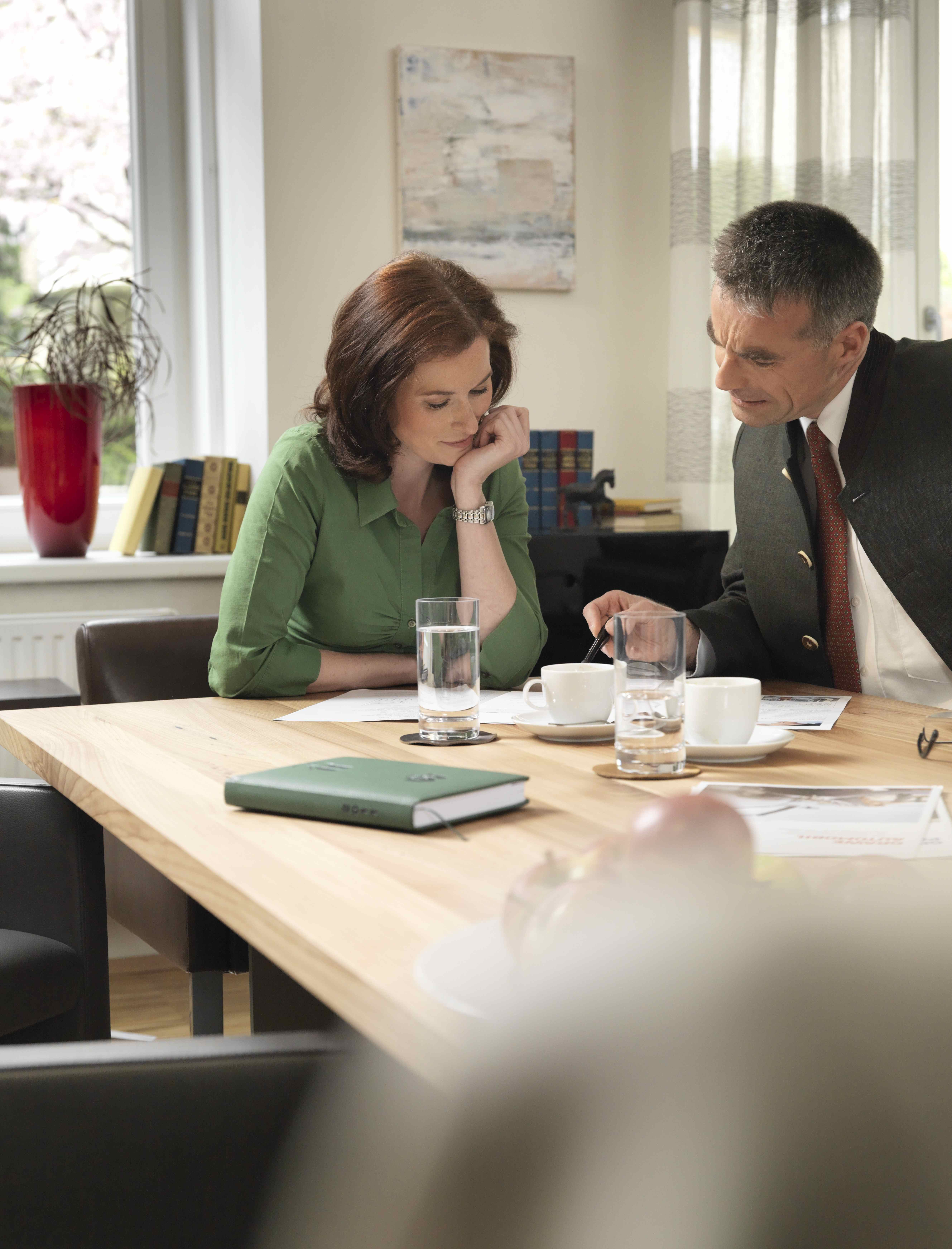 Insurance broker consulting a woman